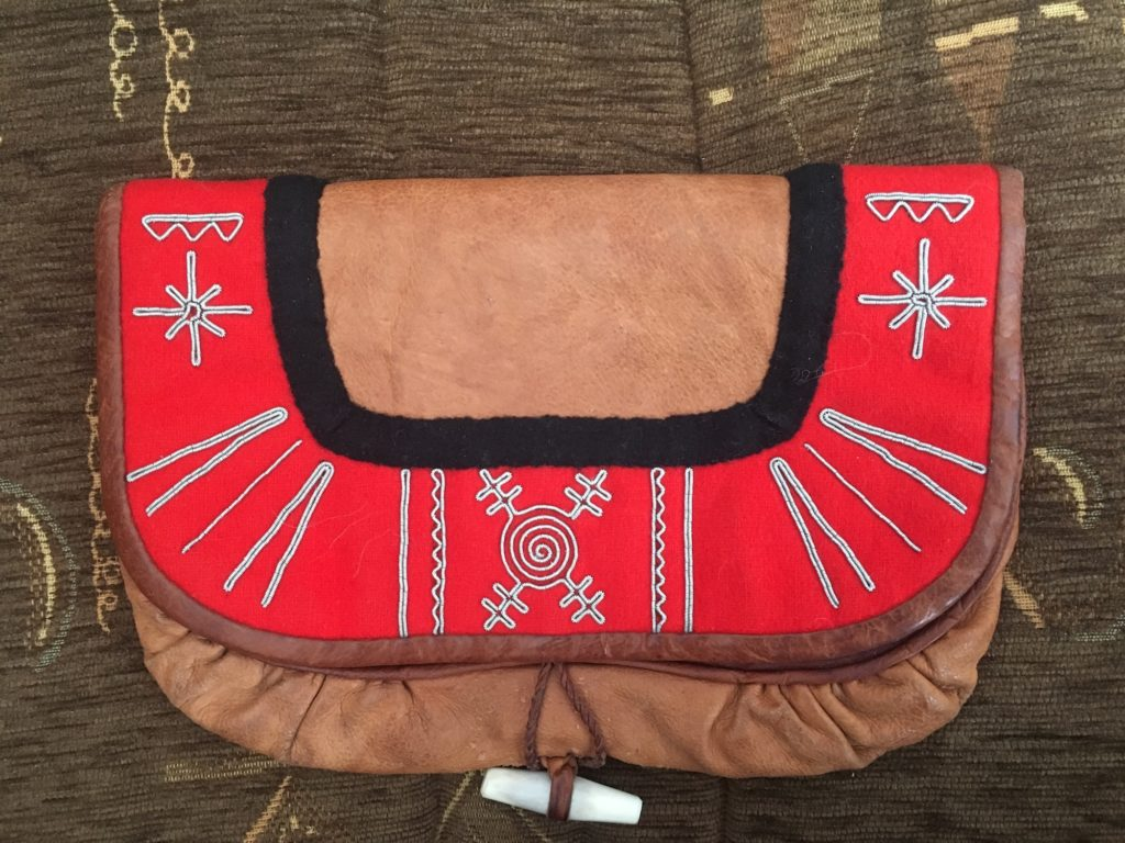 Tin thread embroidery on reindeer skin bag